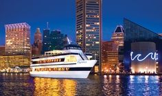 Aboard a cruise ship, guests enjoy scenic views of Baltimore's historical Inner Harbor, a classic dinner buffet, and a caring wait staff