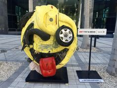 "Sprint's ""The Last Emoji"" sculpture – created from a junkyard wreck – shows the twisted consequences of texting and driving in downtown Miami."