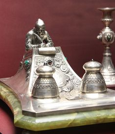 A gorgeous silver inkwell holder on green jade.