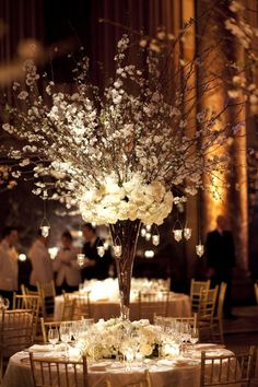 Tall Centerpiece - this is what I had in mind for tall arrangements - not that wide and using white hydrangea instead of white roses -- more cost effective