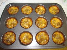 I made Taco Bites for dinner! Wonton wrappers, refried beans, browned ground beef, and cheese - bake at 425 for 8-10 minutes - we added sour cream after they were baked, and they are yum!