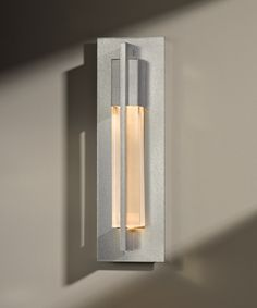 "BASE ITEM NUMBER: 206420 DESCRIPTION: Axis; Direct wire wall sconce; small. Aluminum U.S. Patent D690871 S DIMENSIONS: 15"" h. x 4.6"" w. MAX. HANGING WEIGHT: 5.2 lbs. SOCKET TYPE: G-9 halogen BULB: (1) G-9, 40 watt max. SHOWN IN: Vintage Platinum finish (-82) with clear glass (ZM331) GLASS COLOR OPTION: ZM - Clear	 Clear"
