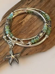 This Stunning Bohemian Style Bracelet/Necklace will be noticed and adored! Beautiful colors of aqua blue/green and silver! The beads used in this wrap are high quality crystal glass Czech beads. It has beautiful silver tube beads and textured Tibetan beads throughout! Its made to