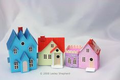 Three traditional printable cottages and landscaped bases for an N-scale Christmas village scene in traditional North American Putz or Glitter style.