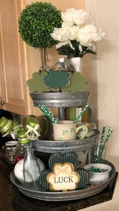 Decorated St Patrick's Day tiered stand 3 Tier Stand, Tiered Stand, St Patrick's Day Decorations, Holiday Centerpieces, St Patrick Decorations, Table Centerpieces, Sant Patrick, Galvanized Tray, Luck Of The Irish