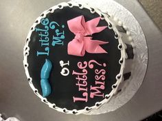 Gender reveal cake...this would be cuter if it wasn't black. I like the little mr? little miss? Plus I'm sure Happy Cakes could make a better mustache