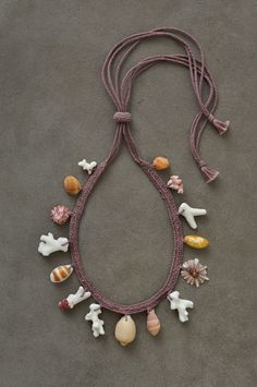 Jurgen Lehl - Coral and shell necklace with natural dye cotton yarn.