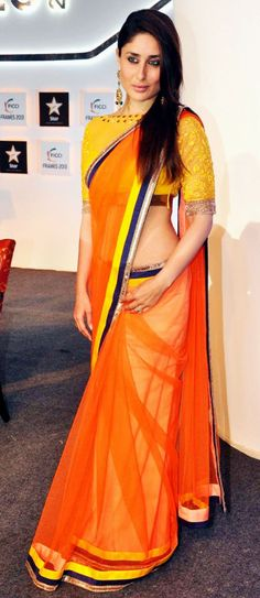 My new saree is exactly like this with design on the net ..just opposite colours... orange blouse and yellow saree with orange border