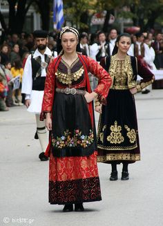 Folk dancers with traditional-costumes.