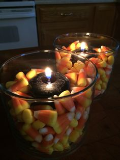 Reused candle jar from Bath and body works, small black Yankee candles surrounded by candy corn.