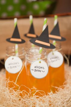 Halloween Party Witches' Brew - Dress up a glass of juice with a witch's hat straw, and give it a fun name like witches' brew.