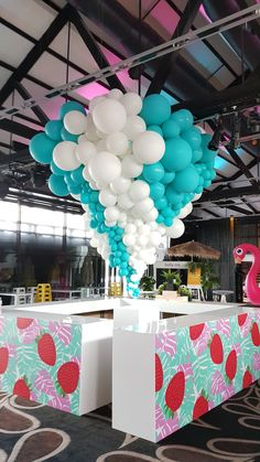 Giant tapered organic installation hangs over a bar for this boutique event. www.balloons.net.au.