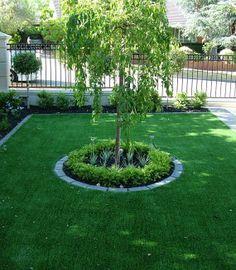 Circular masonry garden bed