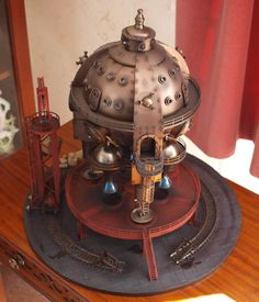 Steampunk spaceship in the style of a Cavorite sphere