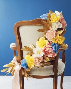 Make your sweetheart chairs extra fab by wrapping a simple but super colorful paper flower garland around them.