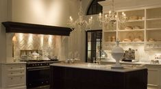 Julie Charbonneau Classic French Kitchen - so much more elegant than the faux variety in trendy homes.