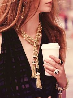 Where's Liborace?? Tassel necklace. (Plus notice that she's drinking coffee. My kinda girl!!)