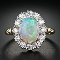 Opal and diamond ring.  If you love this check out Renaissance Fine Jewelry in Vermont. www.vermontjewel.com