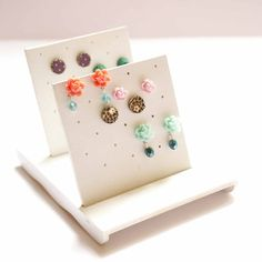 A simple way to store your studs - simply cut out a sheet of any material, poke some holes, and voila!