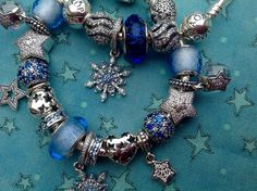 Pandora  Beautiful collection of stars! Blue and silver stars and snowflakes charms.