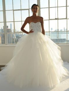 Marchesa Fall 2016 lace and floral arch embroidery in corset ball gown wedding dress with mutli-tiered ruffle skirt | https://www.theknot.com/content/marchesa-wedding-dresses-bridal-fashion-week-fall-2016