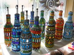mosaic bottles..glorious!! THIS is what I have been gluing up all those wine bottles for . . .