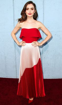 Lily Collins in a strapless red and pink pleated dress
