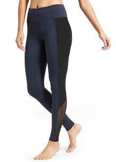 "V-neck 3/4 length sleeves Split sides Hi-lo hem Allover knit construction Boxy fit Approx. 23"" sh"