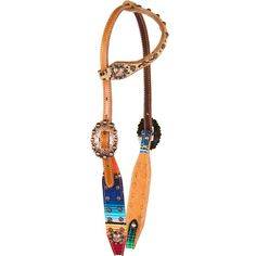 Only at Teskey's! Cactus Saddlery one ear headstall from the Fallon Taylor collection features serape print overlay outlined with copper parachute dots and copper berry buckles to dress up it up! Includes floral tooling, light oil finish, and stainless steel hardware. Pair with the matching Fallon Taylor leopard and serape one ear headstall, browband headstall, leopard wither strap, or breastcollar for the perfect match!