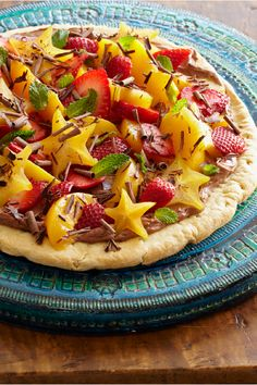 Fruit-Topped Chocolate Cream Pizza – This sophisticated fruit pizza recipe is made with a blend of softened cream cheese and chocolate-hazelnut spread and garnished with chocolate curls. Plus, this dessert sweet treat is ready in just 25 minutes.