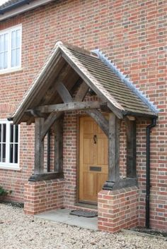 An oak porch can bring about a terrific transformation to the façade of any house, making even a simple front door a pretty and welcoming entrance
