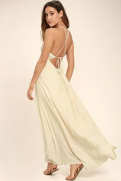Don't let the Beautiful Moment Light Beige Lace Maxi Dress slip away! A modified halter neckline tops an intricate, floral crochet lace bodice, with crossing straps that tie atop the sexy, open back. Gauzy, woven maxi skirt flows from a gathered waistline (with elastic at back).