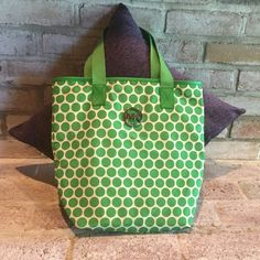 Authentic Michael Kors Bucket Bag Kelly green used tote. There are some signs of wear, please see the pictures. The most wear on in the inside of the inside pocket. Besides the pocket, the inside of the bag is clean. Most wear on the outside is on the bottom and a couple spots on the body as pictured. Michael Kors Bags Totes