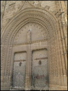 Church Doors  Taken in Javea - Spain the big cathedral dominates the square - built with the local Toscan Stone!