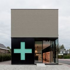 Belgian pharmacy. The green cross indicates it's open. When closed, it turns red.