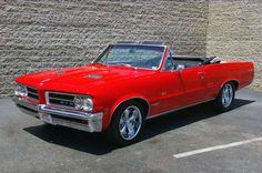1964 Pontiac GTO.  The car that inspired the song by the Beach Boys.  Also, the first car to come with three 2-barrel carburetors from the factory.