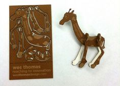 pop out / puzzle business card where you get to make an animal