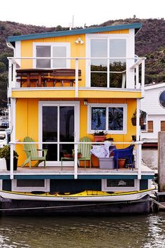 Houseboat | This is magnificent. | Bold yellow humble abode.