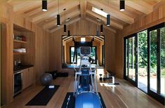 home gym. Nice wood-work, clean design; needs more equipment space, larger mirror area, add wider area for aerobics, barre...