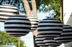 Chic Ways To Incorporate Black & White Stripes Into Your Wedding {Part - Bridal Musings I'm guessing just use a sharpie to add the black to white paper lanterns. The White Stripes, Black And White, Black Tie, Chandelier Bougie, Nightmare Before Christmas Wedding, White Paper Lanterns, Hanging Lanterns, Black White Parties, Black Party