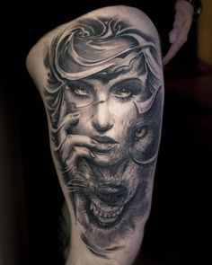 Black and grey woman and wolf tattoo on the right thigh. Tattoo artist: Victor Portugal