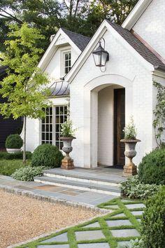 Beautiful white brick home exterior.