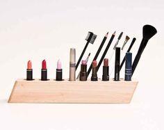 A geometric makeup organizer made of wood: