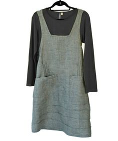 Winter sale: $36 off every Pinnie! This is the dress you have been waiting for. A crisscross, vee back pinafore with two big pockets and chic pin tucks for a flattering shape. No buttons, no zippers .