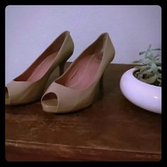 """Authentic Vince Camuto Heels Authentic Vince Camuto heels. Open toes / peep toe.  Size 7 1/2 Used. Nude/ Tan color. Any more info needed please ask. Minor scuffs. However on heel part of shoe ( inside shoe) is sticker residue from heel protectors. I believe this is the """" kiley"""" Vince Camuto Shoes Heels"""