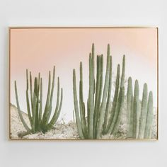 Inspired by midcentury photos of Palm Springs, this gold-framed cactus image conjures the warm desert air and sun with the nostalgic look of a rosy hand-painted sky.