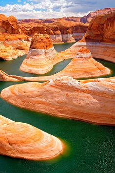 Utah, Lake Powell is a huge man-made reservoir visited by people every year. It straddles both Utah and Arizona. The water is stunningly blue and the rocks contrast beautifully in hues of red, orange and yellow. In the adjacent Glen Canyon Natio Beautiful Places To Travel, Cool Places To Visit, Travel Photographie, Vacation Spots, Travel Pictures, Travel Usa, The Great Outdoors, Wonders Of The World, Travel Destinations
