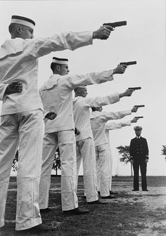 Five cadets at the U.S. Naval Academy, Annapolis, shooting pistols. July 1942.