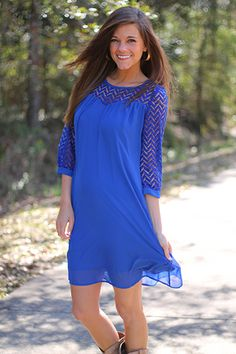 """Hello gorgeous!! We love the stand out color and of course the crochet detailinggg!! This one is lined and looks great with cowboy boots, wedges, or even flats!   Fits true to size. Miranda is wearing the small  From shoulder to hem:  small=36.5""""  medium=37  large=37.5"""