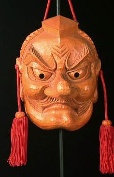 Tengu mask  Japan  8 inches, wood, heavy cord  Tengu are some of the oldest mythological deities in Japan. They inhabit trees, are good swordsmen, and are fond of playing tricks on human beings. Being part bird and part man, they have wings and large noses or beaks